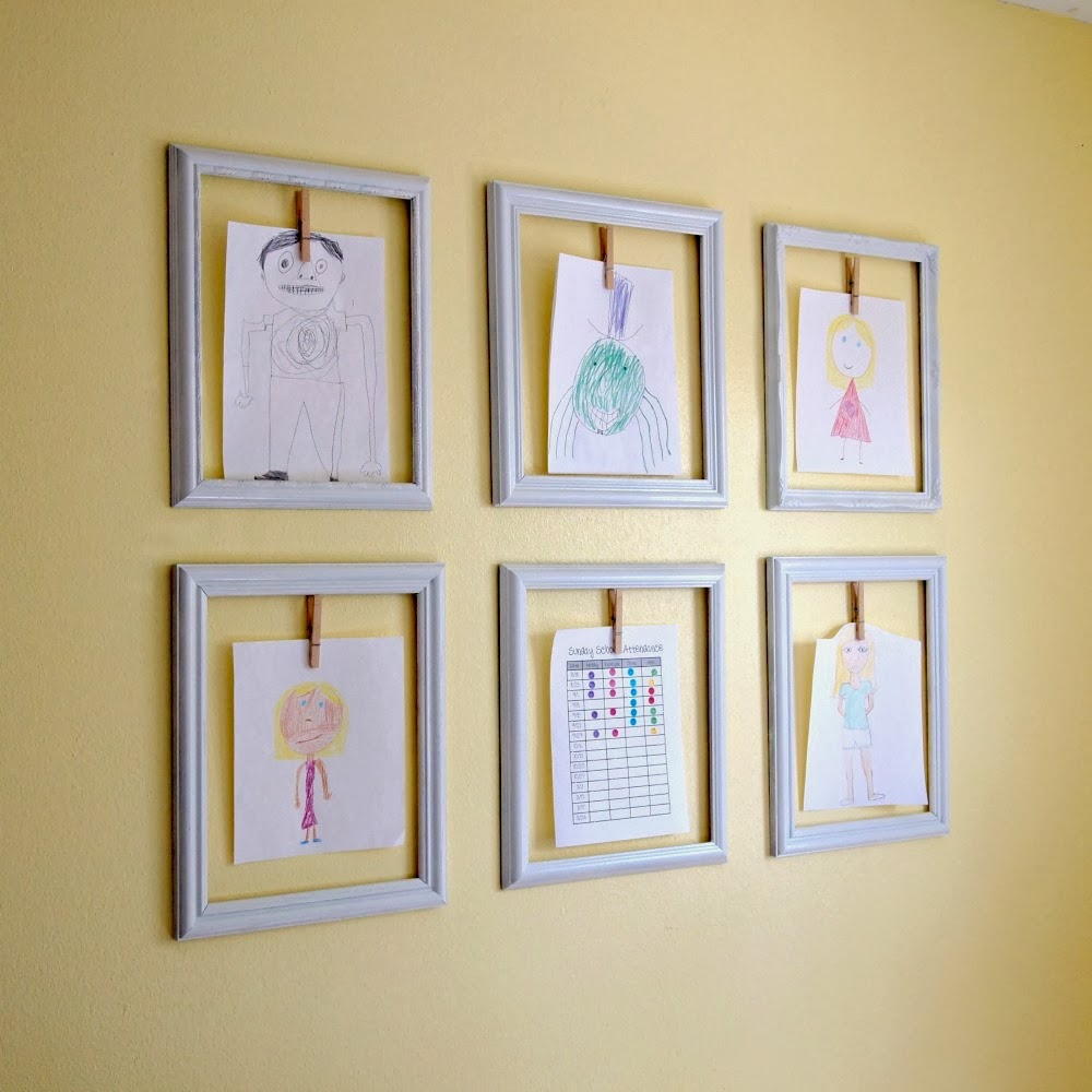 kids art display with frames and cloth pins