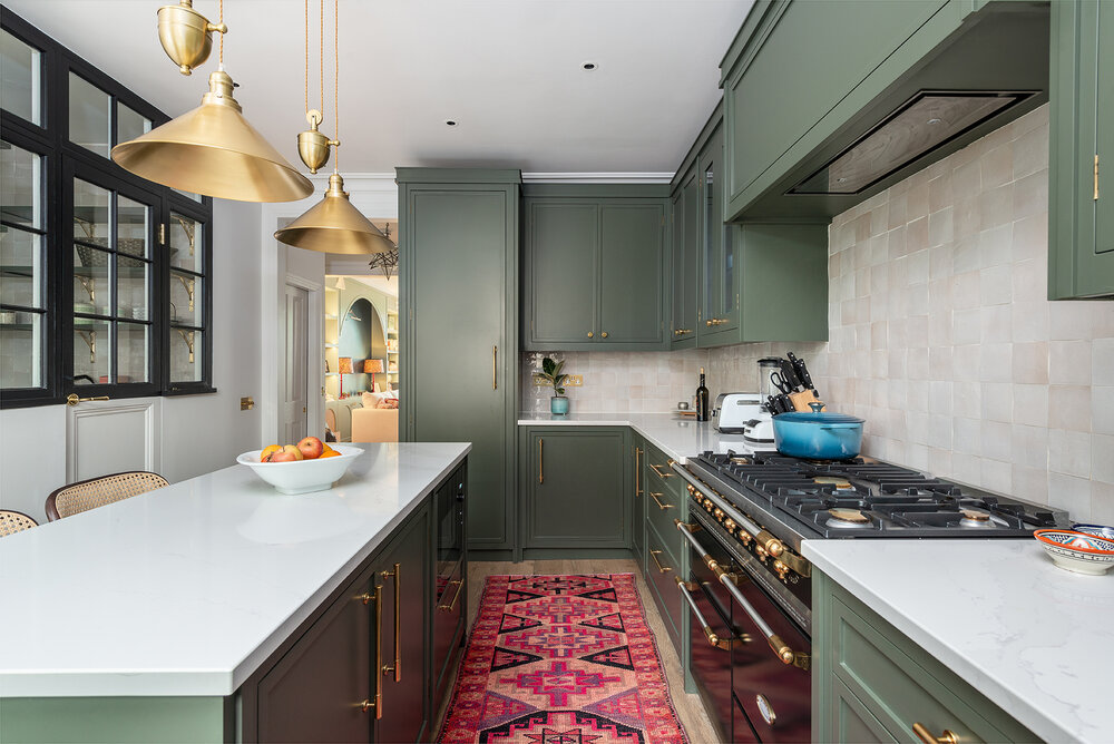olive green cabinets with brass hardware